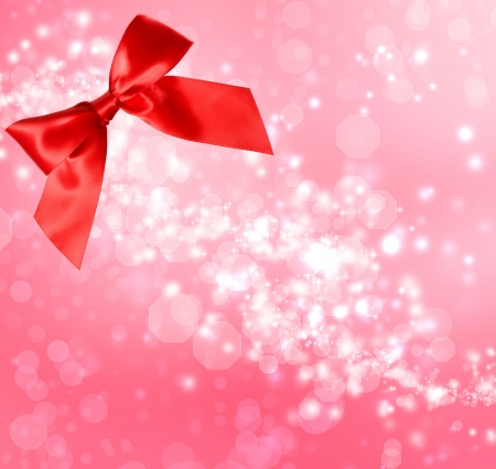 Red Satin Bow with  Pink Bokeh Lights Background  photo