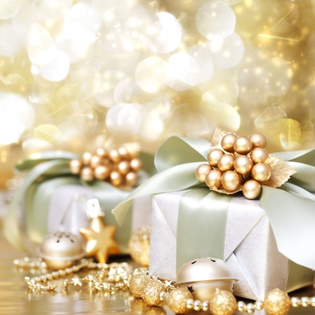 new year eve beads: Christmas Gift Box over Golden Shiny Background