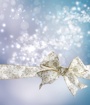 White Snowflake Bow and Ribbon with Bokeh Lights Background  Stock Photo