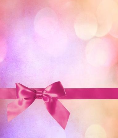 moño rosa: Lazo rosa y la cinta con el fondo abstracto Luces