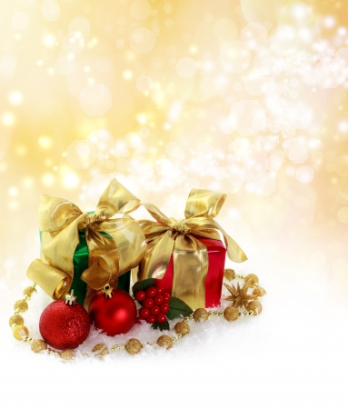 Red and green Christmas gifts over golden lights background Stock Photo - 16578879