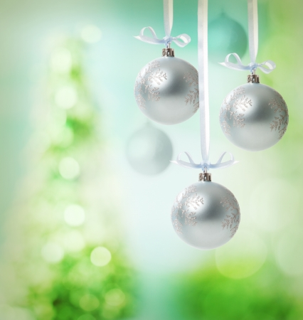 Christmas snowflake ornaments over green tree lights background Stock Photo - 16578877