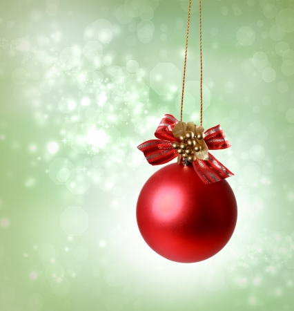 Christmas red ornaments over green tree lights background Stock Photo - 16578882