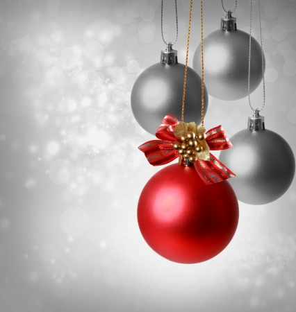 Christmas red ornaments over silver lights background Stock Photo - 16578876