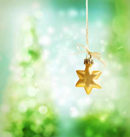 Christmas star ornament over green tree lights background Stock Photo - 16630427