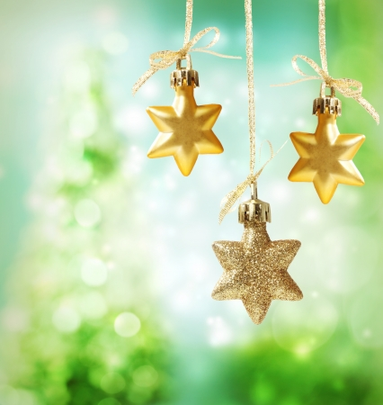 Christmas star ornaments over green tree lights background Stock Photo - 16630436