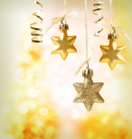 Christmas star ornaments over yellow orange lights background Stock Photo - 16630432