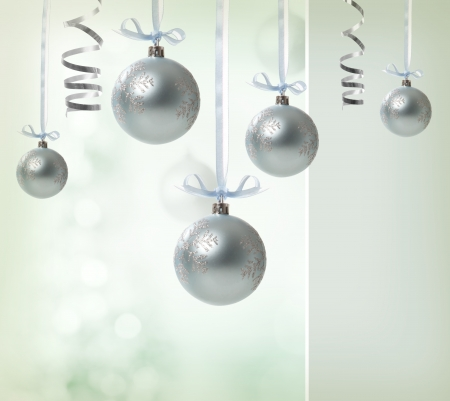 Silver Christmas Ornaments over glowing background Stock Photo - 16630366