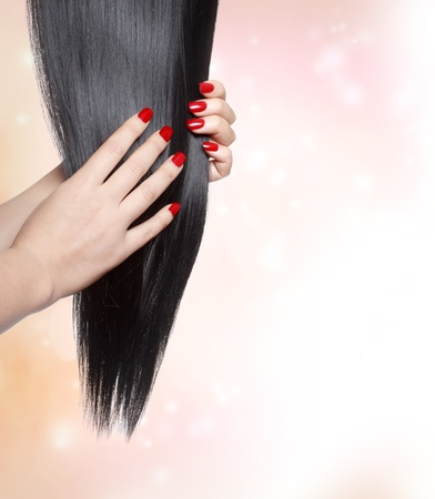 Long straight black hair with red nails photo