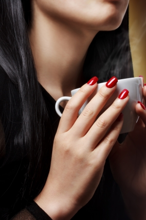 nails: Beautiful woman holding a hot beverage (coffee - tea)