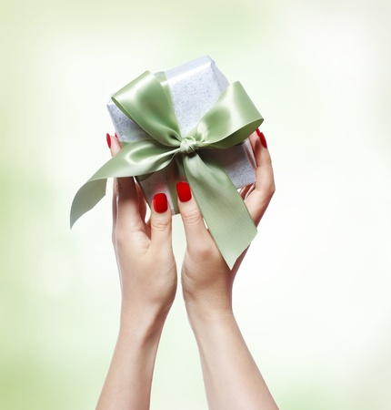 nails: Woman Holding a Small Gift Box Stock Photo
