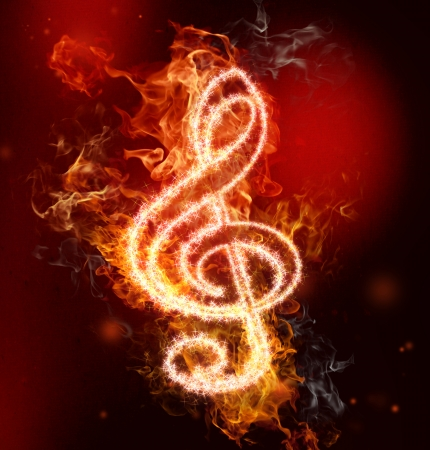 g clef: G clef in fire on red and black background Stock Photo