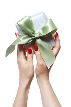 christmas manicure: Woman Holding a Small Gift Box Stock Photo