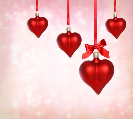 Valentine heart ornaments with pink light background photo