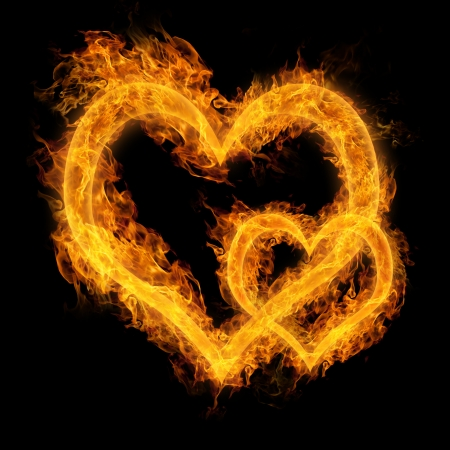 two hearts: Heart made of fire on black background Stock Photo