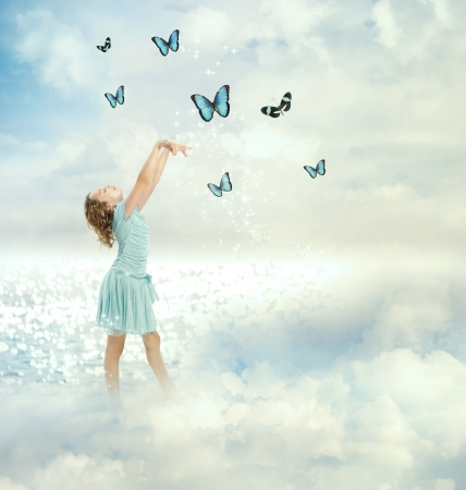 dream lake: Little girl in a blue dress with blue butterflies (Fantasy) Stock Photo