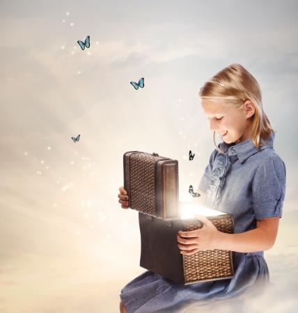 magic box: Happy Blond Girl Opening a Treasure Box
