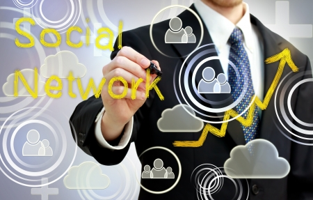 Businessman drawing social network with rising arrows Stock Photo - 17526697