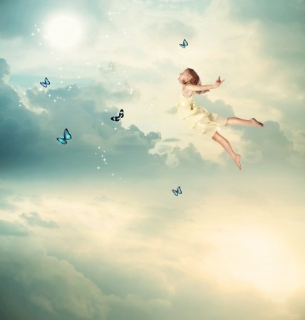concept magical universe: Little Blonde Girl Flying with Butterflies at Twilight