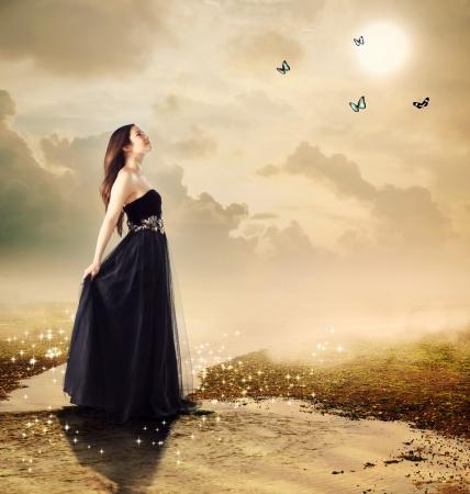 black princess: Beautiful girl at a brook under the moon light (with butterflies)