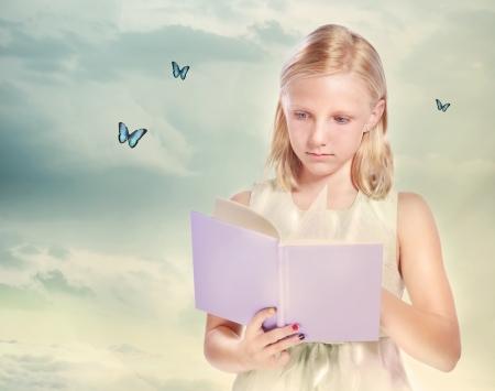 book: Little Blonde Girl Reading a Book with Butterflies