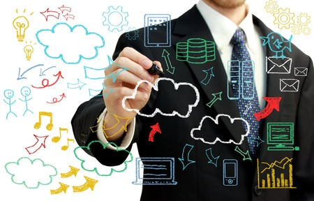 Businessman with hand written cloud computing themed texts and pictures Stock Photo - 17848737