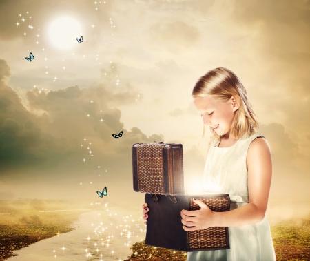 treasure box: Happy Blonde Girl Opening a Treasure Box