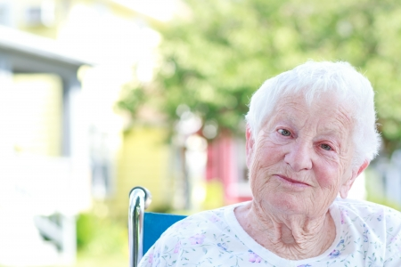 the elderly residence: Happy Senior Woman in a Wheelchair Outside Stock Photo