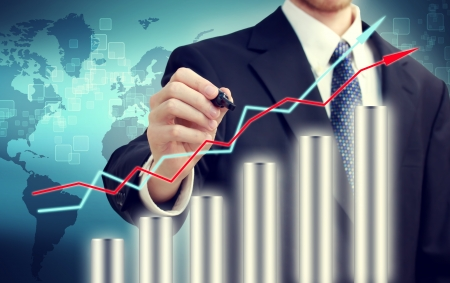 representing: Businessman with graph representing growth