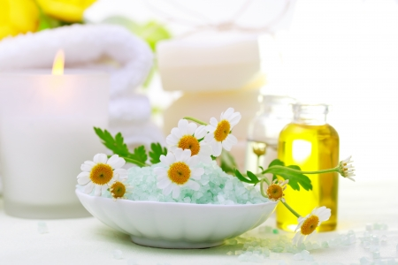 Spa relaxation theme with flowers, bath salt, essential oil, towels and candles photo