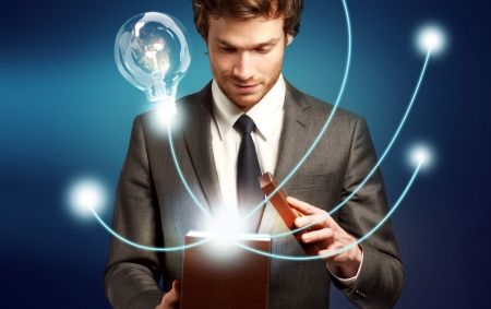 Young Man Thinking Outside the Box, Brilliant Ideas, Eureka Stock Photo