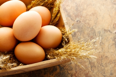 brown eggs: Brown eggs in wooden square bowl Stock Photo