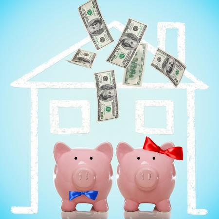 Piggy bank couple buying or dreaming of a new home with flying money photo