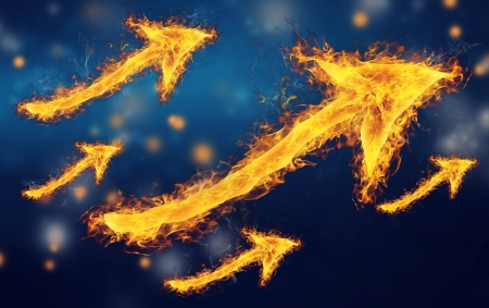 Flaming rising arrows on dark blue background Stock Photo - 18656977