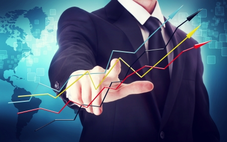 Businessman with arrows representing growth   photo