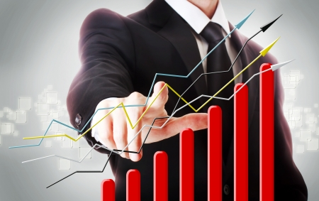 finacial: Businessman with graph representing growth