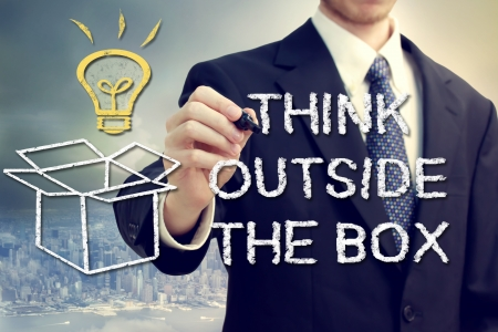 outside box: Businessman drawing thinking outside the box theme