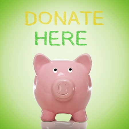 Piggy bank with donate here text on green background