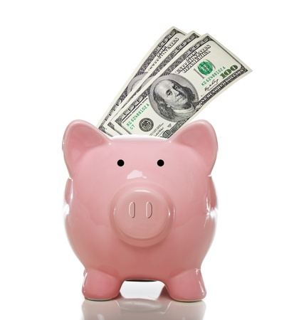 one hundred dollars: Pink piggy bank with 3 one hundred US dollar bills on a white background