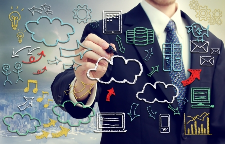 business graphics: Businessman with hand written cloud computing themed texts and pictures