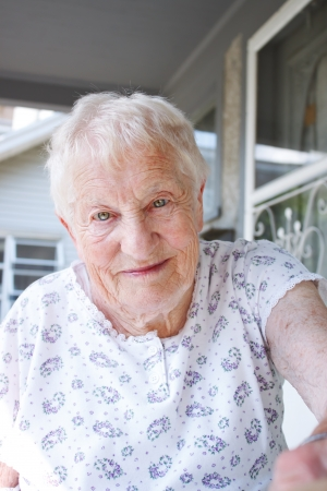 Portrait of happy senior lady in front of a house Stock Photo - 20016919