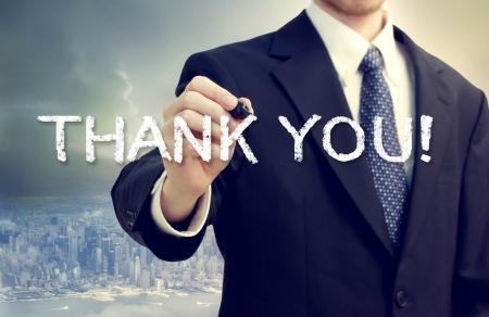 ビジネス男ありがとう大都市背景上に描画 写真素材