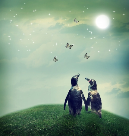 Penguins: Two penguin friendship or love theme image at a fantasy landscape Stock Photo