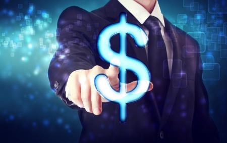 Zakenman wijzend Dollar icoon met blauwe tech achtergrond Stockfoto