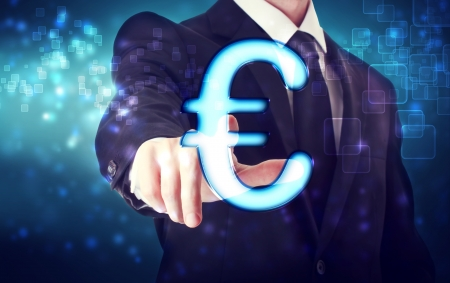 Businessman pointing Euro icon with blue tech background photo