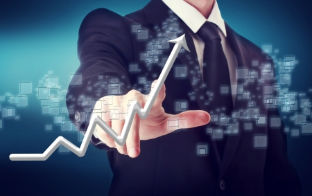 navy blue background: Businessman Touching a Arrow Indicating Growth on navy blue background