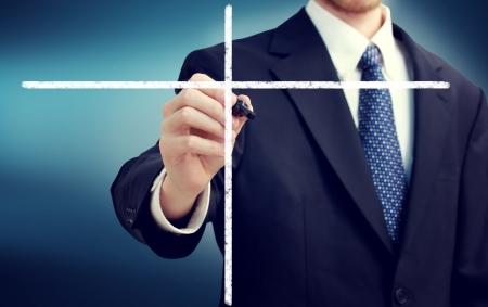 navy blue background: Businessman writing lists with a navy blue background Stock Photo