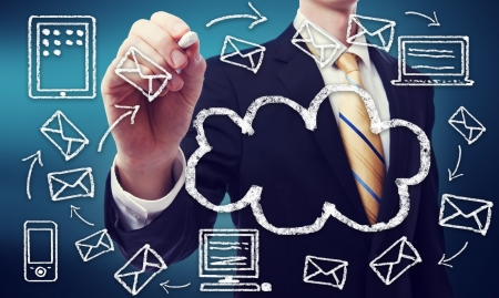 e mail: Businessman with cloud computing and connectivity concept Stock Photo