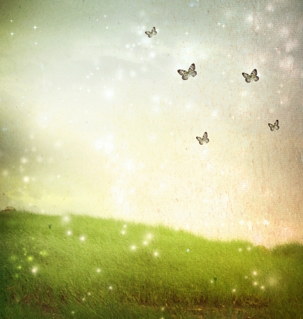 Butterflies in a fantasy landscape - vintage paper style photo