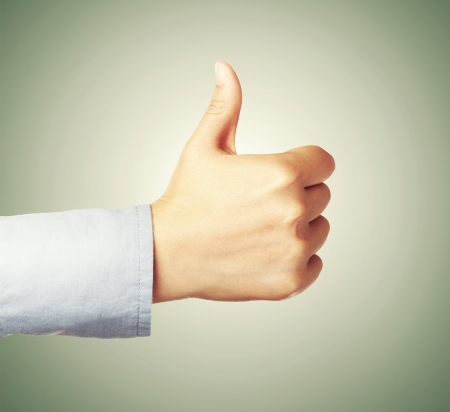 ok sign: Giving thumbs up or like on green background